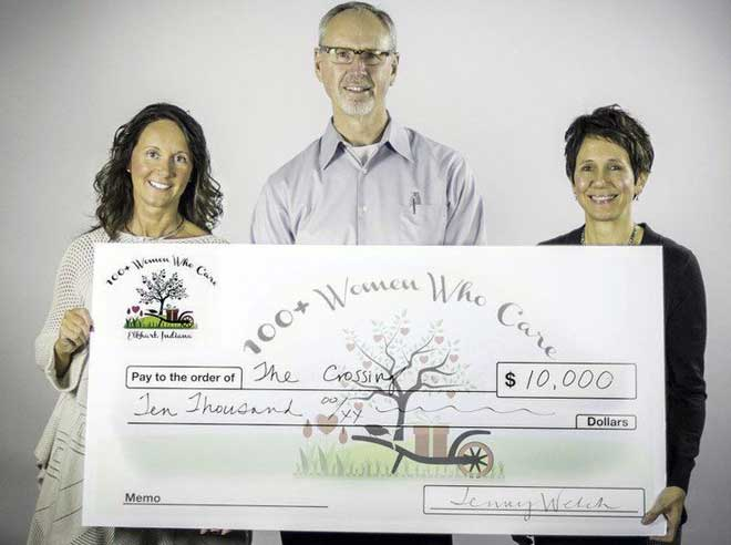 100 women who care Elkhart check presentation to The Crossing